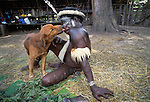 Dani man with his pet dog, Grand Valley, Papua, Indonesia