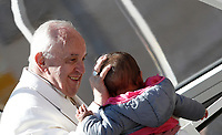 Papa Francesco accarezza una bambina al termine dell'udienza generale del mercoledi' in Piazza San Pietro, Citta' del Vaticano, 19 aprile, 2017.<br /> Pope Francis caresses a child at the end of his weekly general audience in St. Peter's Squareat the Vatican, on April 19 2017.<br /> UPDATE IMAGES PRESS/Isabella Bonotto<br /> <br /> STRICTLY ONLY FOR EDITORIAL USE