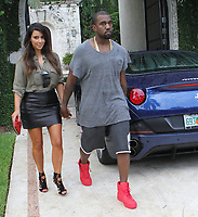 MIAMI, FL - OCTOBER 08:  Kim Kardashian is said to be devastated that her ex, Reggie Bush is expecting a baby with his girlfriend, Lilit Avagyan She was seen today walking in the rain hand and hand in Miami house hunting with boyfriend Kanye West . on October 8, 2012 in Miami, Florida.<br /> CAP/MPI122<br /> ©MPI122/Capital Pictures