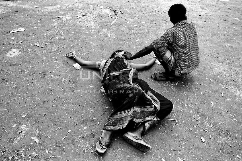 After the 16 days of the Rana plaza collapse, Mother of a missing garments worker lost her sense after found the decomposed dead body of her daughter at Adhar Chandha High School. Savar, Bangladesh.