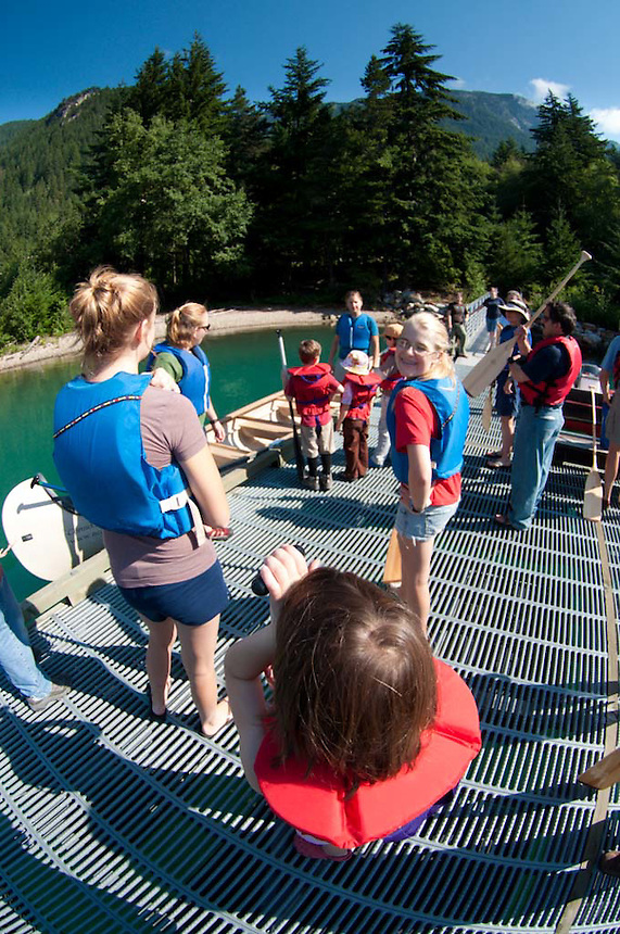 Getting On Board the North Cascade Institute's Twelve Person Canoe on Diablo Lake, North Cascades National Park, Washington, US
