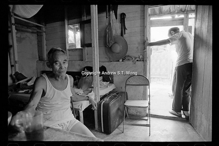 Elderly Hong Kong Chinese miners rest inside their hut at Ma On Shan iron mine in the New Territories, Hong Kong, 1985. Hundreds of miners fled mainland China to Hong Kong in 1949 after the Communist Party victory in the civil war. They lived a destitute life in Hong Kong.