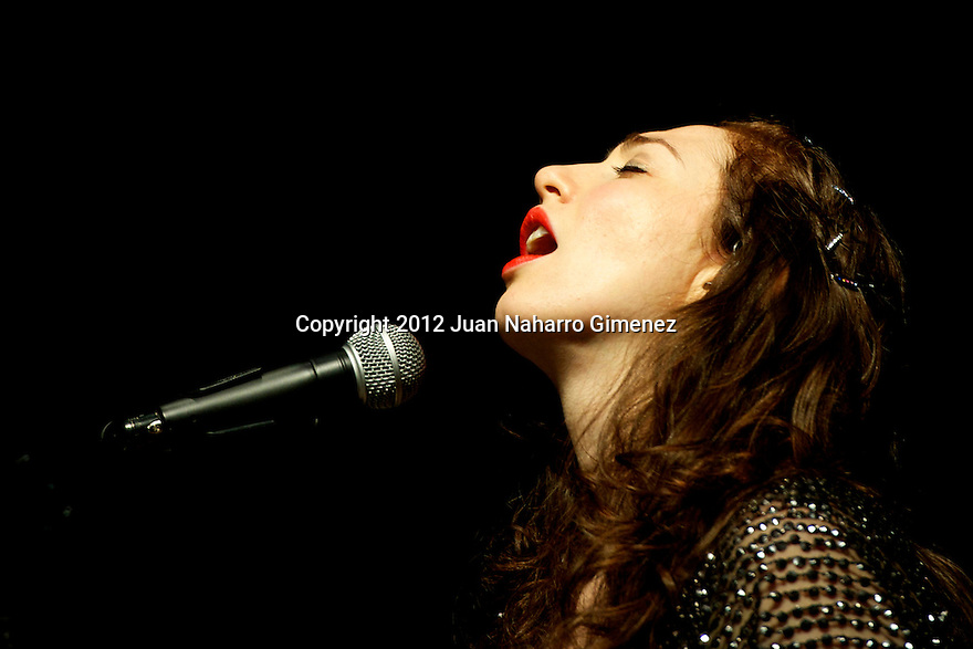 "MADRID, SPAIN - JULY 09:  Singer Regina Spektor performs on stage during ""Veranos de la Villa 2012"" at Teatro Circo Price on July 9, 2012 in Madrid, Spain.  (Photo by Juan Naharro Gimenez)"