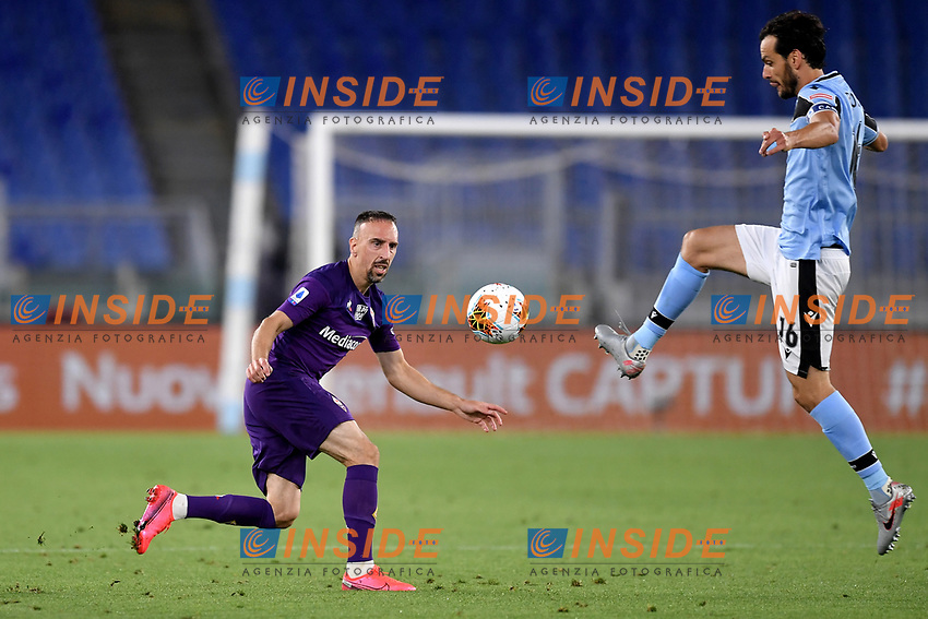 Franck Ribery of Fiorentina and Marco Parolo of SS Lazio compete for the ball during the Serie A football match between SS Lazio and ACF Fiorentina at stadio Olimpico in Roma ( Italy ), June 27th, 2020. Play resumes behind closed doors following the outbreak of the coronavirus disease. Photo Antonietta Baldassarre / Insidefoto