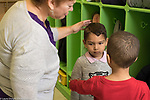 Education Preschool 4-5 year olss classroom scenes boy sad about separation in the morning teacher and classmate responding