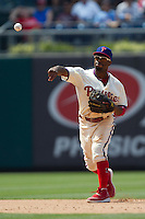 Philadelphia Phillies shortstop Jimmy Rollins #11 throws to first during the Major League Baseball game against the Pittsburgh Pirates on June 28, 2012 at Citizens Bank Park in Philadelphia, Pennsylvania. The Pirates defeated the Phillies 5-4. (Andrew Woolley/Four Seam Images).