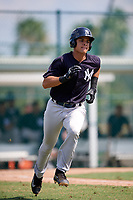 New York Yankees Pedro Diaz (45) runs to first base during an Instructional League game against the Pittsburgh Pirates on September 28, 2017 at Pirate City in Bradenton, Florida.  (Mike Janes/Four Seam Images)