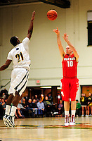 21 January 2010: Stony Brook University Seawolves' guard Bryan Dougher, a Sophomore from Scotch Plains, NJ, shoots for three against the University of Vermont Catamounts at Patrick Gymnasium in Burlington, Vermont. The Catamounts fell to the Seawolves 65-60 in the America East matchup. Mandatory Credit: Ed Wolfstein Photo