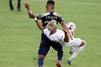 CARY, NC - AUGUST 01: DJ Taylor #27 knocks Mikey Lopez #5 off of the ball during a game between Birmingham Legion FC and North Carolina FC at Sahlen's Stadium at WakeMed Soccer Park on August 01, 2020 in Cary, North Carolina.