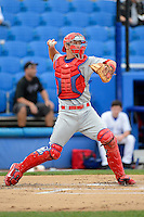 Clearwater Threshers catcher Logan Moore #5 during a game against the Dunedin Blue Jays at Florida Auto Exchange Stadium on April 4, 2013 in Dunedin, Florida.  Dunedin defeated Clearwater 4-2.  (Mike Janes/Four Seam Images)