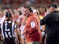 NWA Democrat-Gazette/BEN GOFF @NWABENGOFF<br /> Bret Bielema, Arkansas coach, talks to officials after an Arkansas touchdown pass was called back on a penalty in the fourth quarter on Saturday Sept. 19, 2015 during the game against Texas Tech in Razorback Stadium in Fayetteville.