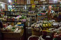 Yogyakarta, Java, Indonesia.  Traditional Herbal Medicine Shop and Pharmacist, Beringharjo Market.