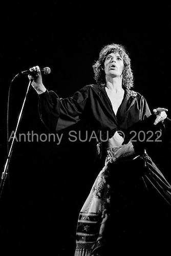 """Chicago, Illinois<br /> July 23, 1975<br /> USA<br /> <br /> Lead singer Mick Jagger of the Rolling Stones performs live at Chicago Stadium during the band's """"Rolling Stones Tour of the Americas '75"""".<br /> <br /> This was the Stones first tour with new guitarist Ronnie Wood, after Mick Taylor left the band. The Stones, with their usual act freshly aided by theatrical stage props including a giant inflatable phallus (nicknamed 'Tired Grandfather' by the band, since it sometimes malfunctioned) and, at the Chicago shows, an unfolding lotus flower-shaped stage that Charlie Watts had conceived.<br /> <br /> The band was composed of  Mick Jagger - vocals, guitar, harmonica, Keith Richards - guitar, vocals, Bill Wyman - bass guitar, and Charlie Watts - drums, percussion. <br /> <br /> Additional musicians included: Ronnie Wood - guitar, backing vocals, Ian Stewart - piano, Billy Preston - keyboards, vocals and Ollie Brown - percussion."""