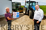 Agri-consultant Philip O'Dwyer (front right) demonstrates the dangers of working on a farm to Bill Joe Leen on his farm in Causeway on Tuesday.