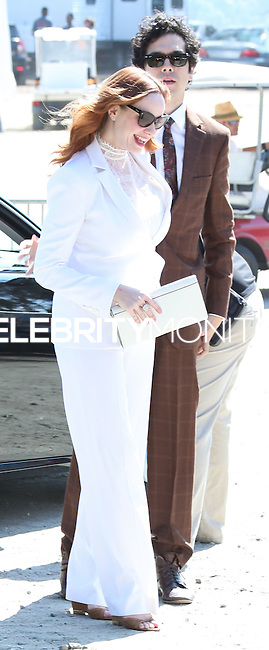 PACIFIC PALISADES, CA, USA - OCTOBER 11: Christina Hendricks, Geoffrey Arend arrives at the 5th Annual Veuve Clicquot Polo Classic held at Will Rogers State Historic Park on October 11, 2014 in Pacific Palisades, California, United States. (Photo by Xavier Collin/Celebrity Monitor)