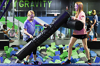 Hannah Russell, 10, (from left) and Ella Russell, 12, of Springdale play, Friday, July 16, 2021 at Defy Rogers in Rogers. Kids played on trampolines, trapezes and in foam pits at the trampoline and extreme airsports park. Check out nwaonline.com/210717Daily/ for today's photo gallery. <br /> (NWA Democrat-Gazette/Charlie Kaijo)