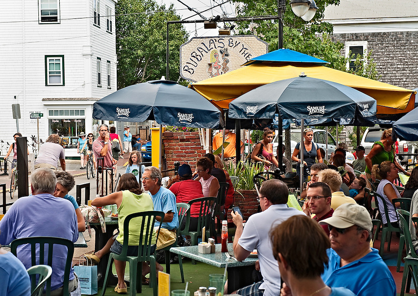 Busy outdoor cafe on Commerce Street, Provincetown, Cape Cod, MA, USA