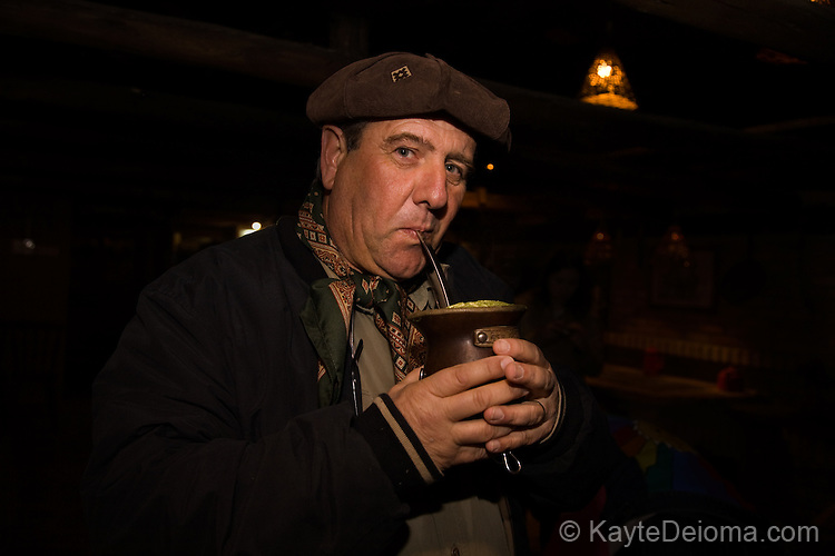 Ivan A. B. Cascaes, owner of Rio do Rastro Eco Resort, sips hot mate from a traditional mug at the Cantinho do Chimarrao Barn Dance at the resort in the mountains of Santa Catarina, Brazil. Horses occupy one end of the barn, cows and sheep the other, with a wood-beamed country pub serving hot mate drinks between the two. The resort hosts a barn dance with regional music and dancing every Saturday night.