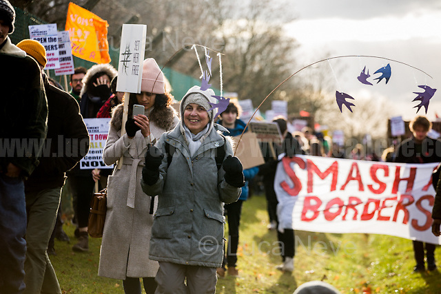 "Bedford (Bedfordshire, England), 03/12/2016. Today, more than two thousand activists and members of the public from across the UK gathered outside the notorious Yarl's Wood I.R.C. Immigration Removal Centre in Bedfordshire, lead by the ""Movement for Justice By Any Means Necessary"" to protest against the alleged inhuman conditions of the detainees (showed in a recent Channel 4 undercover investigation - http://bit.ly/1E6X4pz) and to call for its immediate closure. <<Yarl's Wood Immigration Removal Centre is a detention centre for foreign nationals prior to their deportation from the United Kingdom, one of 13 such centres currently in the UK. It is located near Milton Ernest in Bedfordshire, England, and is operated by Serco (British outsourcing company based in Hook, Hampshire. It operates public and private transport and traffic control, aviation, military weapons, detention centres, prisons and schools on behalf of its customers - Source Wikipedia.org), who describes the place as ""a fully contained residential centre housing adult women and adult family groups awaiting immigration clearance."" Its population is, and has been, overwhelmingly female. […] >> (Source - Wikipedia.org at http://bit.ly/1GiTFWB). The protest of today was the 10th demo organised at Yarl's Wood I.R.C. and the largest ever at a detention centre in the UK.<br />