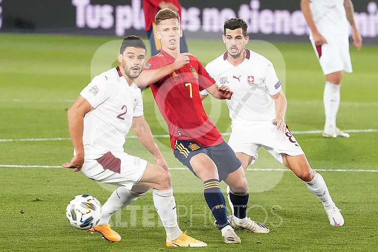 Spain's Dani Olmo (c) and Switzerland's Loris Benito (l) and Remo Freuler during UEFA Nations League 2020 League Phase match. October 10,2020.(ALTERPHOTOS/Acero)