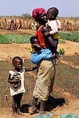 Tankular, The Gambia. Woman and three children on their agricultural plot.