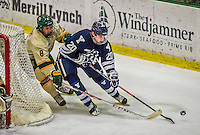 4 January 2014:  Yale University Bulldog forward Jesse Root, a Senior from Pittsburgh, PA, rounds the net as he he is checked by University of Vermont Catamount Forward Jonathan Turk, a Sophomore from Calgary, Alberta, during overtime at Gutterson Fieldhouse in Burlington, Vermont. With an empty net and seconds remaining, the Cats came back to tie the game 3-3 against the 10th seeded Bulldogs. Mandatory Credit: Ed Wolfstein Photo *** RAW (NEF) Image File Available ***