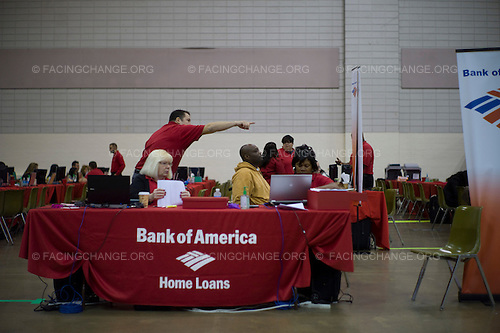 © 2011  David Burnett /Facing Change.October 13, 2011.Memphis, Tennessee.Neighborhood Assistance Corp. of America (NACA).NACA.com  a non profit which works to help home owners re-finance their home loans, and works to undermine predatory lending habits in the marketplace..Cook County Convention Center, Memphis, TN...Dozens of home owners gather early (starting 5 a.m.) and are ushered into the NACA work rooms after an orientation.  They speak with counsellors and are later handed off to bank representatives (Bank of America, Wells Fargo, and Chase are the major ones.) .