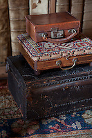 A collection of antique suitcases, part of the Anstruther heritage