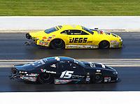 Jun 3, 2018; Joliet, IL, USA; NHRA pro stock driver Jeg Coughlin Jr (far) defeats Tanner Gray during the Route 66 Nationals at Route 66 Raceway. Mandatory Credit: Mark J. Rebilas-USA TODAY Sports