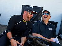 Jun 7, 2015; Englishtown, NJ, USA; NHRA top fuel driver Shawn Langdon (left) with PR rep Rob Goodman during the Summernationals at Old Bridge Township Raceway Park. Mandatory Credit: Mark J. Rebilas-