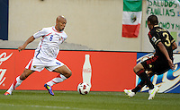 Costa Rica's Heiner Mora makes a move to evade Mexico's Carlos Salcido.  Mexico defeated Costa Rica 4-1 at the 2011 CONCACAF Gold Cup at Soldier Field in Chicago, IL on June 12, 2011.