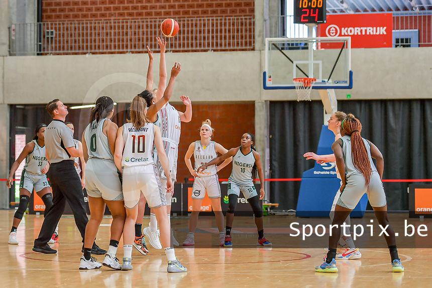 Kyara Linskens (13) of Belgium and Oderah Chidom (22) of Nigeria starting the basketball game between the national teams of Belgium , called the Belgian Cats , and Nigeria on Sunday 30 th of May 2021 in Kortrijk , Belgium . PHOTO SPORTPIX.BE | SPP | STIJN AUDOOREN