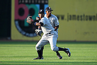 Staten Island Yankees shortstop Jose Mojica fields the ball ahead of Eduardo Sosa during a game vs. the Jamestown Jammers at Russell Diethrick Park in Jamestown Jammers, New York July 15, 2010.   Jamestown defeated Staten Island 5-1.  Photo By Mike Janes/Four Seam Images