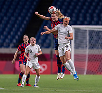 SAITAMA, JAPAN - JULY 24: Samantha Mewis #3 of the USWNT goes up for a header with Hannah Wilkinson #17 of New Zealand during a game between New Zealand and USWNT at Saitama Stadium on July 24, 2021 in Saitama, Japan.