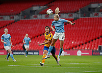 1st November 2020; Wembley Stadium, London, England; Womens FA Cup Final Football, Everton Womens versus Manchester City Womens; Steph Houghton of Manchester City Women heads the ball out from Valerie Gauvin of Everton Women