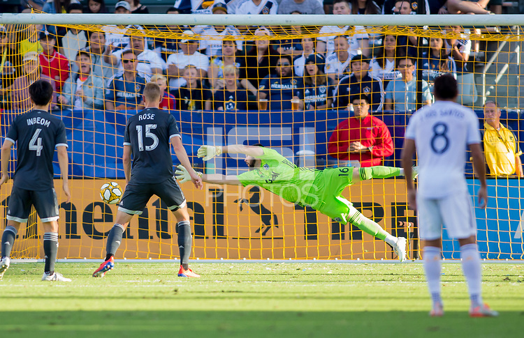 CARSON, CA - SEPTEMBER 29: GK Maxime Crepeau #16 of the Vancouver Whitecaps dives for a ball during a game between Vancouver Whitecaps and Los Angeles Galaxy at Dignity Health Sports Park on September 29, 2019 in Carson, California.