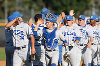 Catcher Jackson Morrow #14 of the UC Santa Barbara Gauchos celebrates with his teammates after a win against the Cal State Northridge Matadors at Matador Field on May 10, 2013 in Northridge, California. UC Santa Barbara defeated Cal State Northridge, 6-1. (Larry Goren/Four Seam Images)