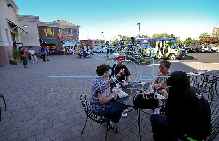 From left, Jerri Powers, Michael Flander and Sheryl Keyes eat outside the Carson Mall during the 20th annual Taste of Downtown event in Carson City, Nev., on Saturday, June 15, 2013. The event features 44 local restaurants in a fundraiser for the Advocates to End Domestic Violence.<br /> Photo by Cathleen Allison