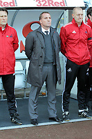 Pictured: Brendan Rodgers manager for Swansea observes a minute's silence  before kick off in memory of Wales football manager Gary Speed who has died. Saturday 27 November 2011<br />