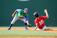 Shortstop Ramon Torres (2) of the Lexington Legends is ready with the ball as Jantzen Witte (35) of the Greenville Drive slides into second base in a game on Sunday, April 27, 2014, at Fluor Field at the West End in Greenville, South Carolina. Greenville won, 21-6. (Tom Priddy/Four Seam Images)