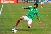 Jonny Magallon (2) of Mexico (MEX) saves a ball headed for the touchline. Mexico (MEX) defeated the United States (USA) 5-0 during the finals of the CONCACAF Gold Cup at Giants Stadium in East Rutherford, NJ, on July 26, 2009.