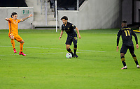 CARSON, CA - OCTOBER 28: Carlos Vela #10 of the Los Angeles FC moves with the ball during a game between Houston Dynamo and Los Angeles FC at Banc of California Stadium on October 28, 2020 in Carson, California.