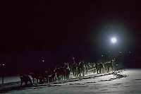Aaron Burmeister teams runs on the trail with his headlamp on as he arrives at the Finger Lake checkpoint early on Monday, March 05, 2018 during the 2018 Iditarod<br /> <br /> Photo by Jeff Schultz/SchultzPhoto.com  (C) 2018  ALL RIGHTS RESERVED