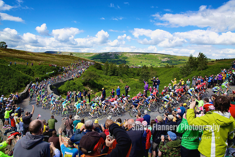 Picture by Shaun Flannery/SWpix.com - 05/07/2014 - Cycling - Tour de France 2014 Grand Depart - Stage 1, Leeds to Harrogate - Yorkshire, England - <br /> Grinton Moor, Yokshire Dales.<br /> The Peloton makes it's way up Grinton Moor on day 1 of Le Tour.