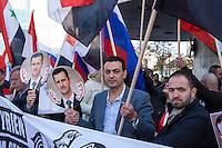 """250 bis 300 Menschen demonstrierten am Samstag den 31. Oktober 2015 in Berlin fuer die Unterstuetzung des syrischen Diktators Assad durch Russland. Sie trugen Fahnen Syriens, der ehemaligen Sowietunion, Russlands, Nordkoreas, der DDR, des Iran und Venezuelas, die sich """"alle zusammen gegen den Imperialismus zur Wehr setzen"""" wuerden. Russlands Praesident Putin wurde ausdruecklich fuer sein Militaerengagement gedankt, das Eingreifen der USA verurteilt.<br /> Im Bild: Demonstranten mit Portraitfotos des syrischen Diktators Assad.<br /> 31.10.2015, Berlin<br /> Copyright: Christian-Ditsch.de<br /> [Inhaltsveraendernde Manipulation des Fotos nur nach ausdruecklicher Genehmigung des Fotografen. Vereinbarungen ueber Abtretung von Persoenlichkeitsrechten/Model Release der abgebildeten Person/Personen liegen nicht vor. NO MODEL RELEASE! Nur fuer Redaktionelle Zwecke. Don't publish without copyright Christian-Ditsch.de, Veroeffentlichung nur mit Fotografennennung, sowie gegen Honorar, MwSt. und Beleg. Konto: I N G - D i B a, IBAN DE58500105175400192269, BIC INGDDEFFXXX, Kontakt: post@christian-ditsch.de<br /> Bei der Bearbeitung der Dateiinformationen darf die Urheberkennzeichnung in den EXIF- und  IPTC-Daten nicht entfernt werden, diese sind in digitalen Medien nach §95c UrhG rechtlich geschuetzt. Der Urhebervermerk wird gemaess §13 UrhG verlangt.]"""