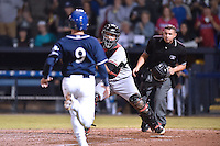 Asheville Tourists catcher Dom Nunez (9) is tagged out at home by Jose Trevino (7) while home plate umpire Jonathan Parra during game 3 of the South Atlantic League Championship Series between the Asheville Tourists and the Hickory Crawdads on September 17, 2015 in Asheville, North Carolina. The Crawdads defeated the Tourists 5-1 to win the championship. (Tony Farlow/Four Seam Images)