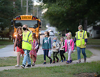 Wednesday, Oct. 6, 2021, walk to school while taking part in the school district's observance of National Walk to School Day in Greenland. National Walk to School day is held on the first Wednesday in October in an effort to raise awareness of the healthy and environmental benefits to walking or biking to school. Visit nwaonline.com/211007Daily/ for today's photo gallery.<br /> (NWA Democrat-Gazette/Andy Shupe)