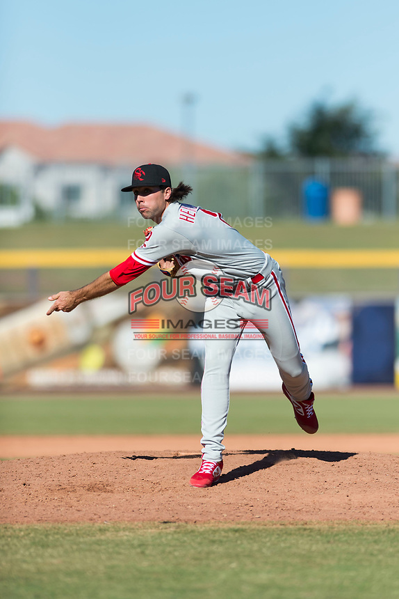 Scottsdale Scorpions relief pitcher Jonathan Hennigan (2), of the Philadelphia Phillies organization, follows through on his delivery during an Arizona Fall League game against the Peoria Javelinas at Peoria Sports Complex on October 18, 2018 in Peoria, Arizona. Scottsdale defeated Peoria 8-0. (Zachary Lucy/Four Seam Images)