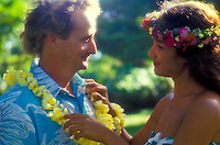 Polynesian woman giving tourist flower lei