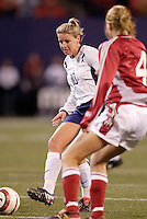 """Denmark's Gitte Andersen watches Aly Wagner of the USA. The US Women's National Team tied the Denmark Women's National Team 1 to 1 during game 8 of the 10 game the """"Fan Celebration Tour"""" at Giant's Stadium, East Rutherford, NJ, on Wednesday, November 3, 2004.."""